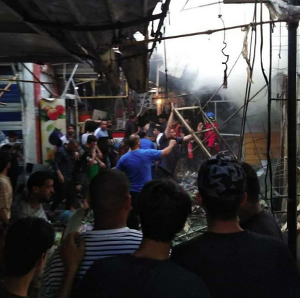 Scene of the attack in the Al-Wahilat open market in Sadr City, in east Baghdad (Al-Sumaria, July 19, 2021)