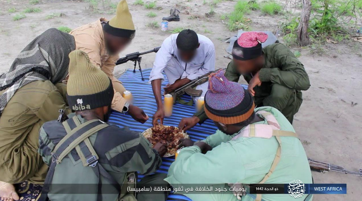 ISIS operatives in Nigeria during a meal.