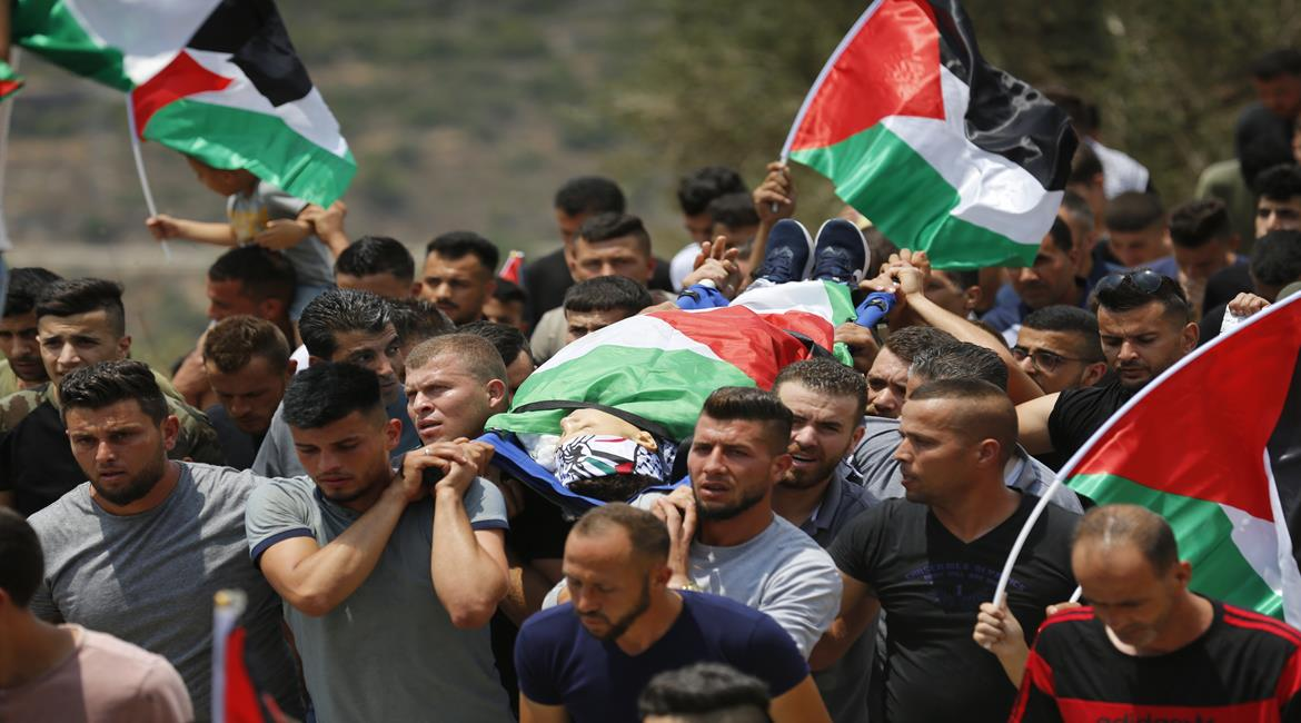 The funeral held in the village of Dir Nidham for Muhammad al-Tamimi (Wafa, July 24, 2021).