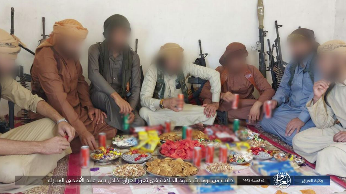 ISIS operatives in Iraq eating the Eid al-Adha meal.