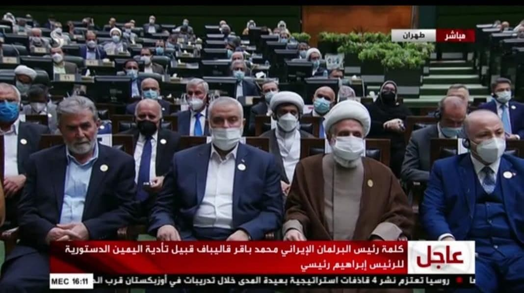 Isma'il Haniyeh, Ziyad al-Nakhalah and Na'im Qassem, deputy head of Hezbollah, sit in the front row during the inauguration of Iranian President Raisi (Shehab Twitter account, August 5, 2021).