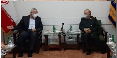 Isma'il Haniyeh (left) with the Hossein Salami, commander of the Iranian Revolutionary Guards Corps.