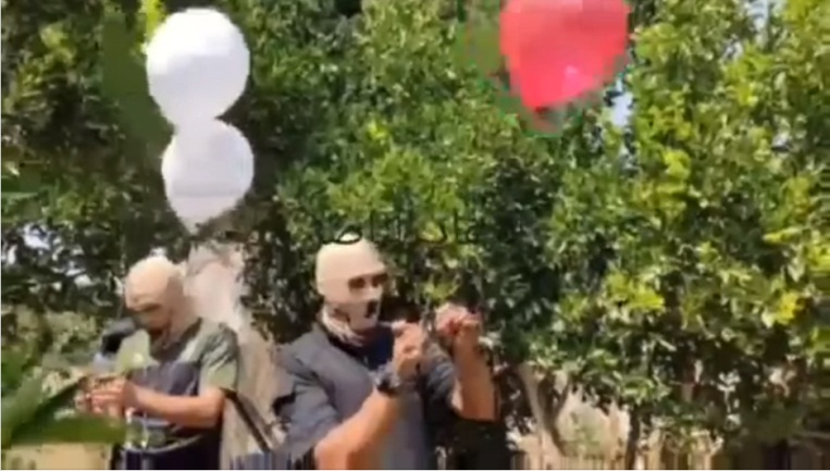 Video issued by the Popular Resistance Committees' Descendants of al-Nasser unit documenting the launching of incendiary balloons from the Gaza Strip into Israeli territory (Descendants of al-Nasser Facebook page, August 11, 2021).