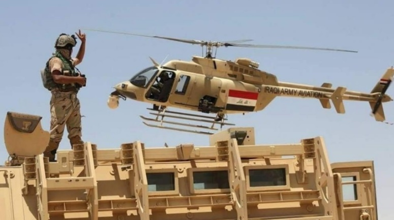 Iraqi army helicopter and armored vehicle during security activity (Al-Sumaria, August 17, 2021)