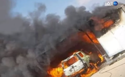 Vehicles going up in flames following the detonation of a car bomb.