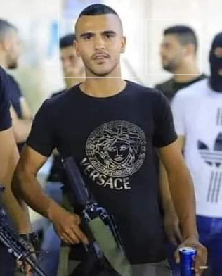 Alaa Zayud, armed with an assault rifle (Facebook page of Sair, September 30, 2021).