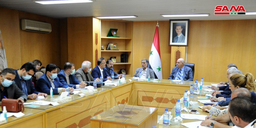 The meeting between the Syrian minister of internal trade and the adviser to the Iranian minister of defense. (SANA, September 21)