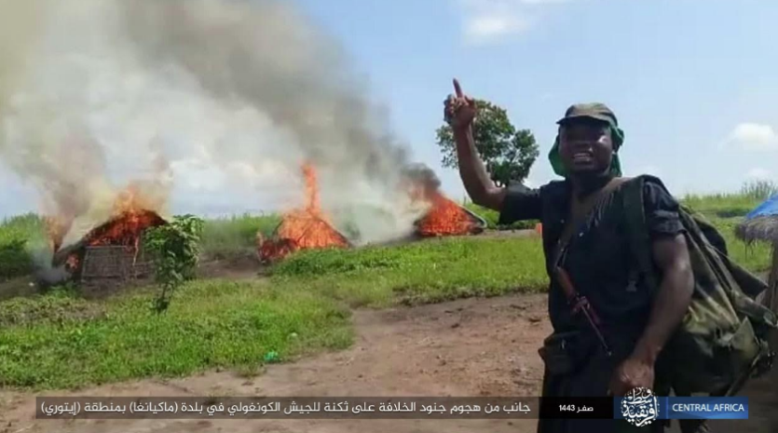 ISIS operative in the village, with the camp that was set on fire in the background (Telegram, October 1, 2021)
